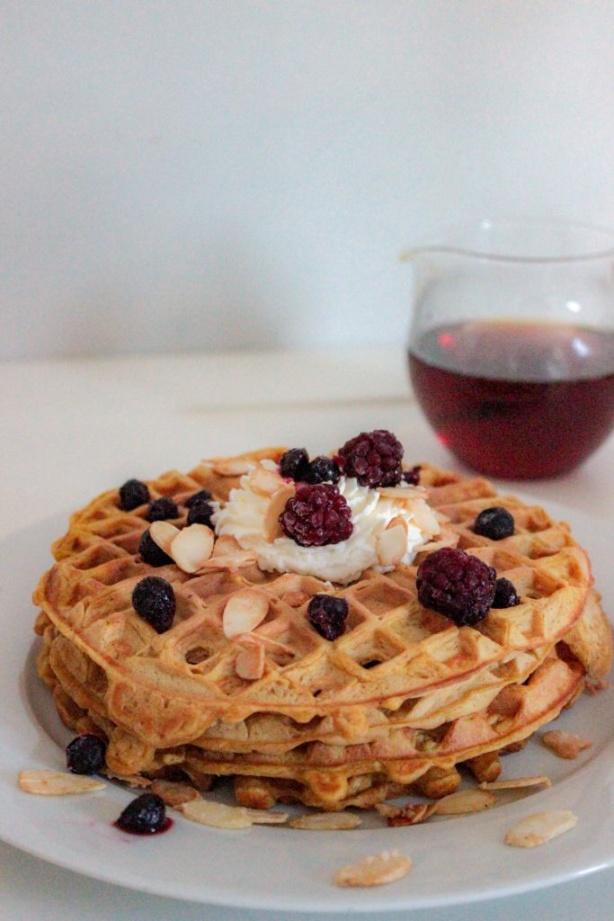 Pumpkin Spice Waffles with Caramelized Almonds and Homemade Whipped Cream