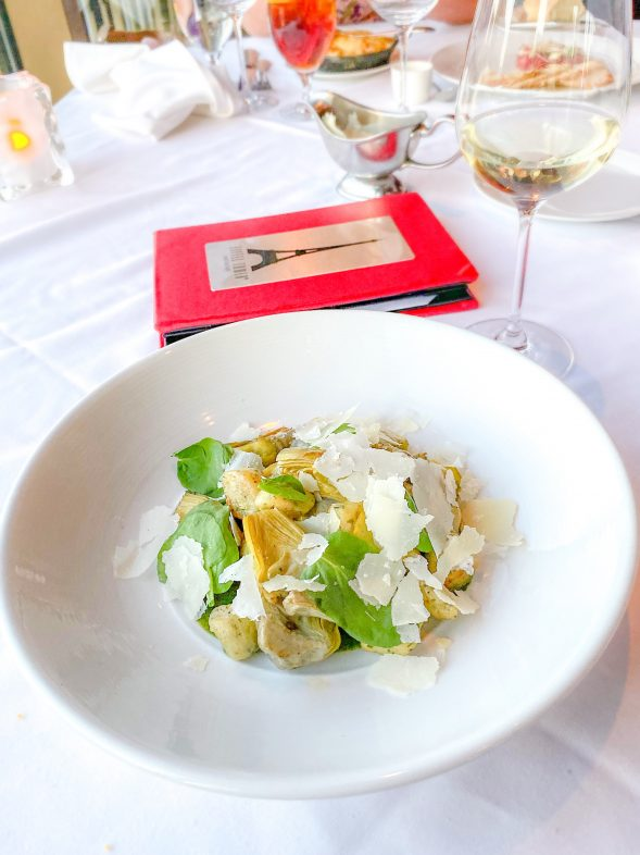 Gnocchi with artichokes and a glass of Pinot Grigio from the Eiffel Tower Restaurant