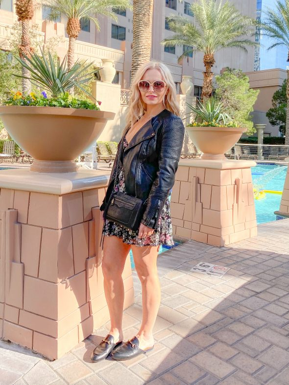 What I wore on the Las Vegas Strip: Superdown floral dress | Topshop vegan leather moto jacket | Rebecca Minkoff crossbody bag | Gucci Princetown mules | Urban Outfitters necklace | Chloe shades