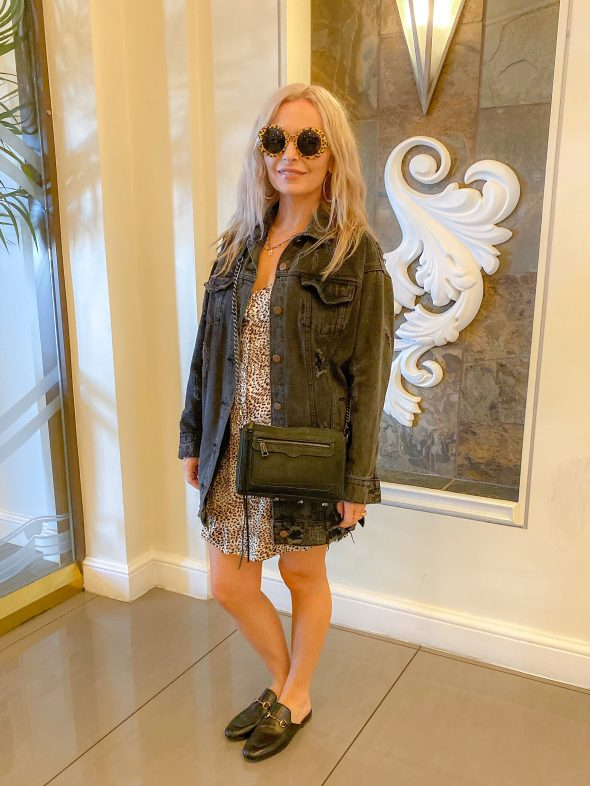 What I wore on the Las Vegas Strip: Amuse Society dress | Denim oversized jacket | Gucci Princetown mules | Rebecca Minkoff crossbody bag | Rebecca Minkoff necklace | Large gold hoops | Cheetah shades